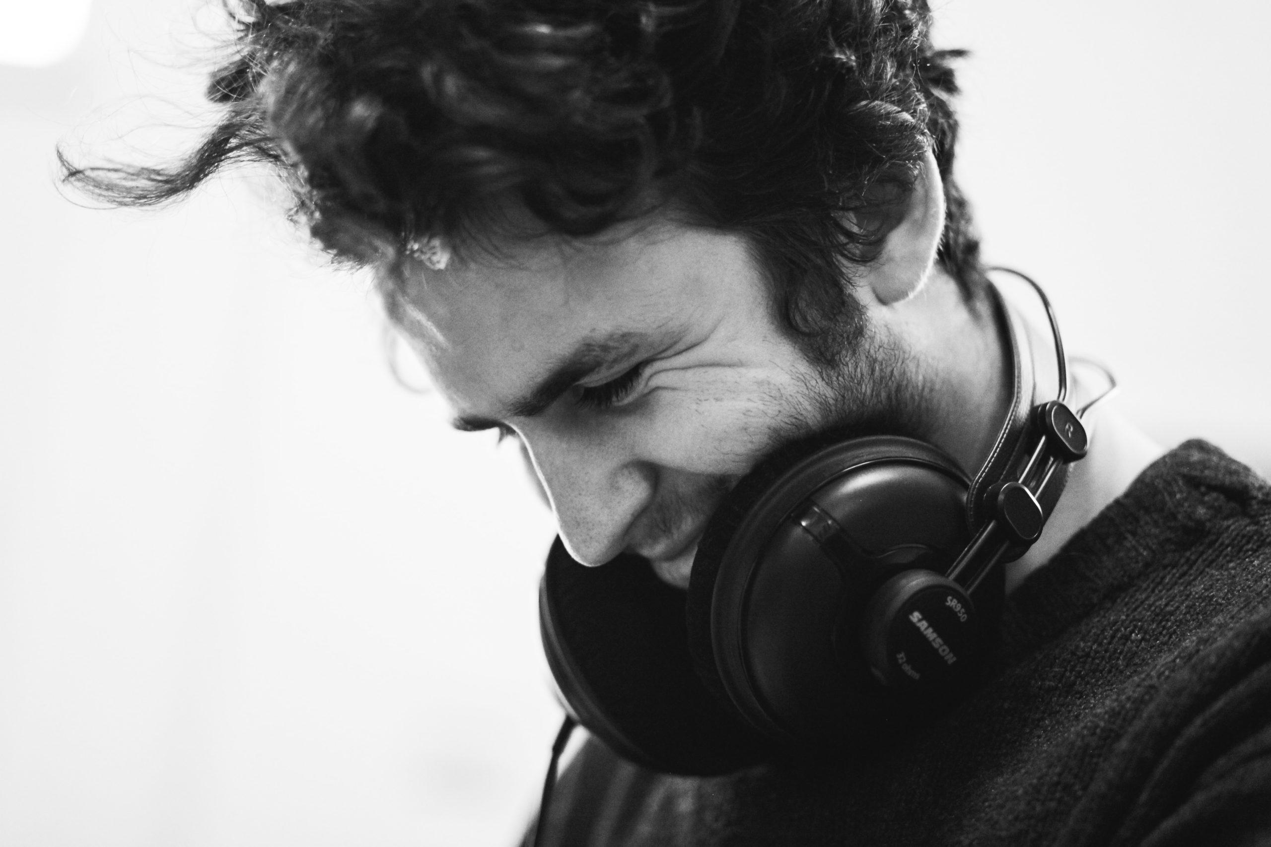 Image of Man smiling wearing headphones
