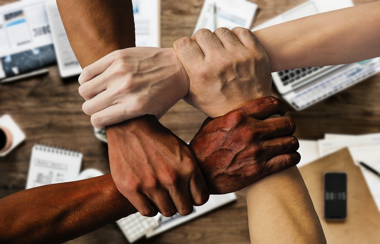 Building Community image of hands supporting each other