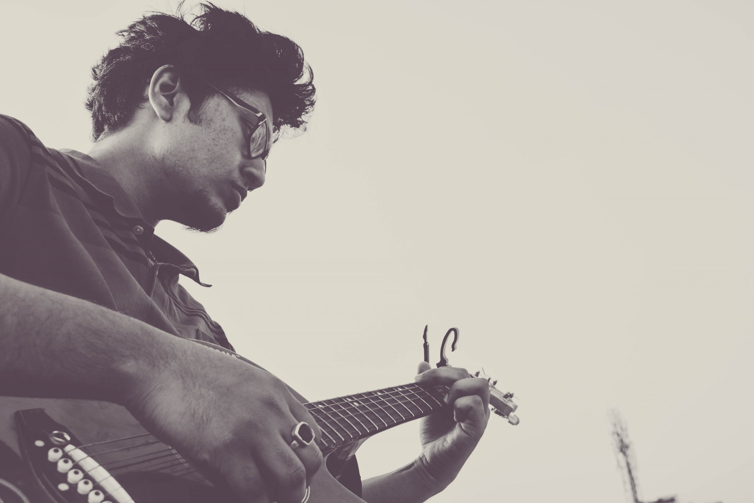 image of musician passionately playing guitar